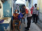 Polres Kep Seribu Ajak Warga Patuh Aturan PPKM dan Terapkan ProKes Sekaligus Bagikan Bansos 69 KK
